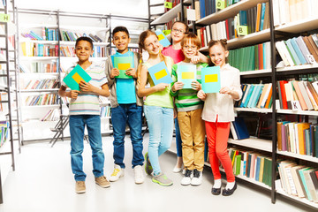 Schoolchildren with exercise books in library
