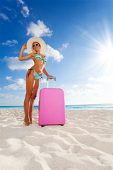 Beautiful woman with suitcase on vacation