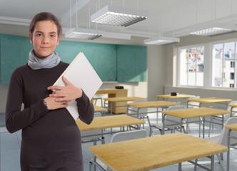 Young schoolgirl in classroom