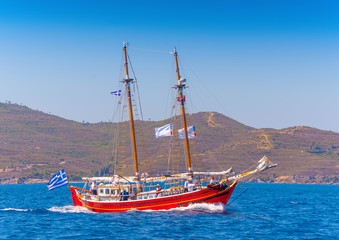 Old wooden red Greek boat (Perama) in Spetses island in Greece