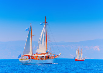 2 Old classic wooden sailing boats in Spetses island in Greece