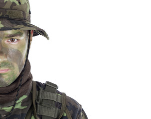 Young soldier with jungle camouflage paint.