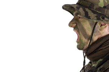 Soldier with jungle camouflage paint shouting out orders