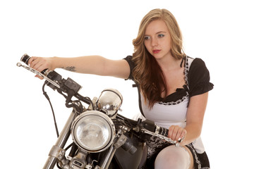 woman black and white dress close on motorcycle