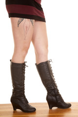 woman legs side boots tattoo