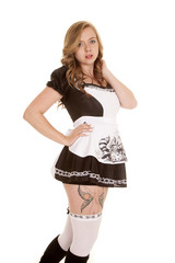 woman maid with tattoo on thigh side stand