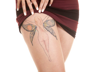 woman show legs fairy tattoo close