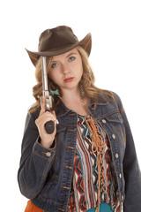 woman pistol on hat serious