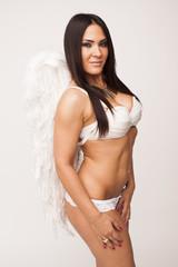 Very sexy sensual brunette woman wearing angel wings