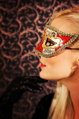 Elegantly dressed light hair model wearing a mask