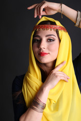 Beautiful oriental girl on dark background