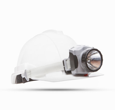 white mining safety helmet with light lamp isolated background