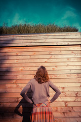 Young woman standing in garden outside cabin