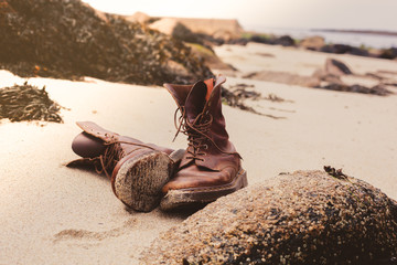 Pair of boots on the beach