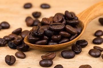 Coffee bean in wooden spoon