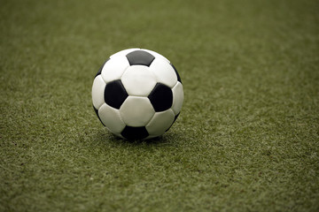 White and black ball for playing soccer close-up