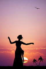 Hawaiian woman dancing at sunset
