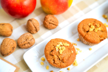 Fototapete - Homemade muffins with apple, chest nut and cinnamon