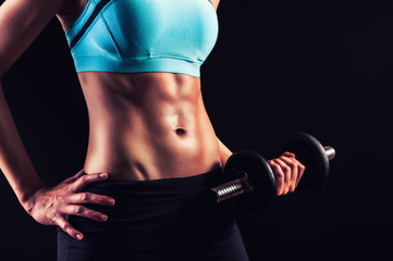 Workout girl with strong abs