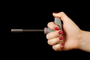 Female hand holding T lug wrench