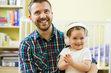 Father and daughter with headphones
