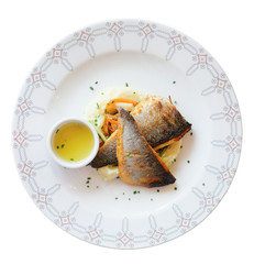Grilled seabass fillet in plate, isolated on white