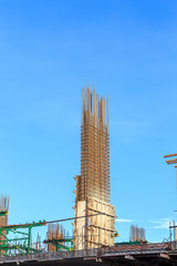building cement pillar in construction site with blue sky