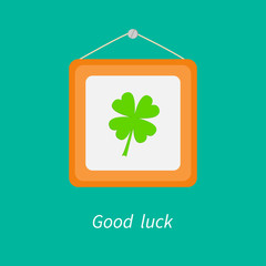 Four leaf clover and picture frame. Good luck. Flat design.