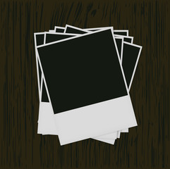 Polaroid photo frame on wood background,Eps 10
