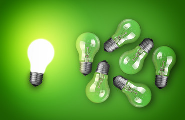 Group of light bulbs on green background