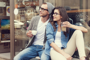 Portrait of stylish couple at outside of cafe Wall mural