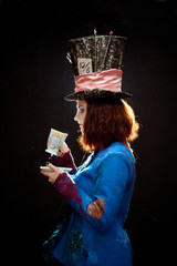 Profile of young woman in the similitude of the Hatter