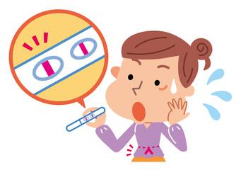 妊娠検査薬を使う女性 妊娠