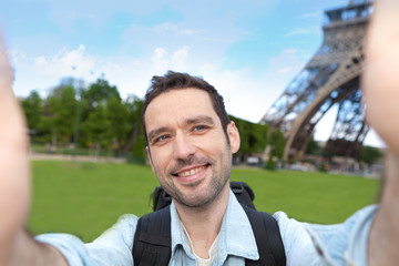 Young attractive tourist taking selfie in Paris