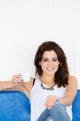 Relaxed tranquil woman drinking coffee