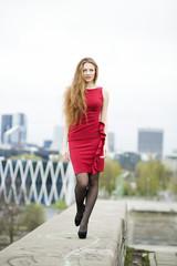 Young woman at dress walk on wharf
