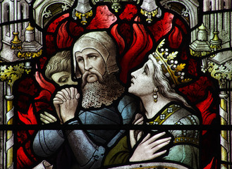 A stained glass window: people in hell