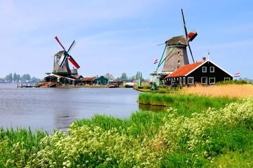 Windmills along a canal at Zaanse Schans, Netherlands