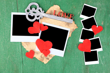 Blank old photos and decorative key, hearts