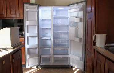 Just Unpacked New Refrigerator with Empty Shelves