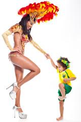 Brazilian child dancing with Samba girl