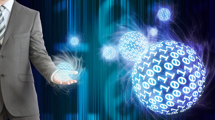 Businessman in suit hold spheres of glowing digits