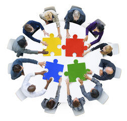 Business People with Jigsaw Puzzle and Teamwork Concept