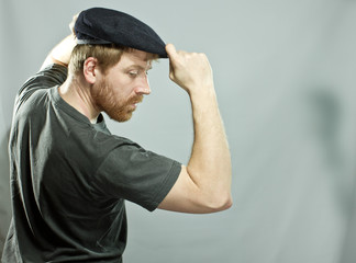 Plumber in hat with red beard