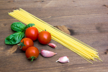 Spaghetti with tomato on wood close up
