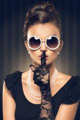 portrait of beautiful brunette woman wearing pearl jewelry and