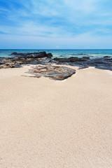 rock, sand, sea and sky