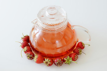 Wall Mural - Teapot with strawberries around it