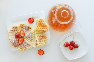Wall Mural - Teapot with waffels on the plate and strawberries