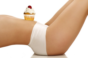closeup on a girl showing a cupcake on her body